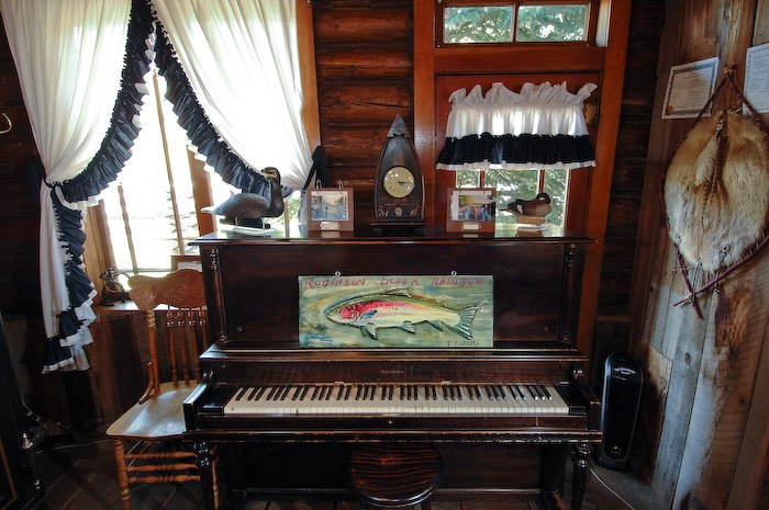 A vintage piano with a custom Robinson Rainbow trout by Tim Borski.