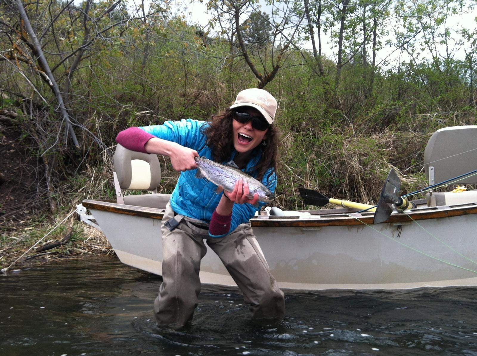 Photo of angler holding a Rainbow Trout.