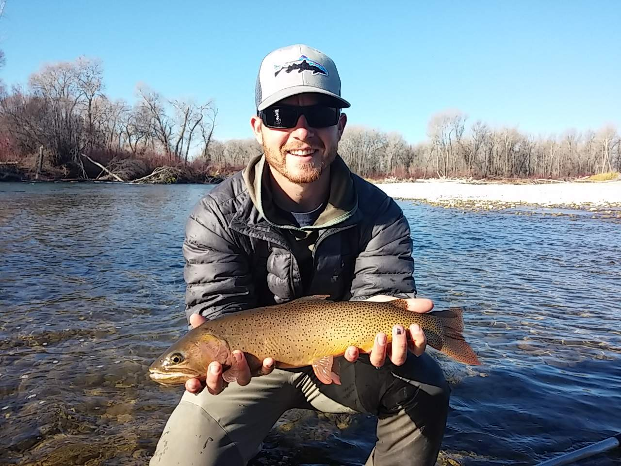 Photo of angler holding large trout.